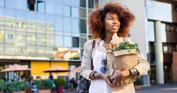 blog picture of lady with groceries smiling