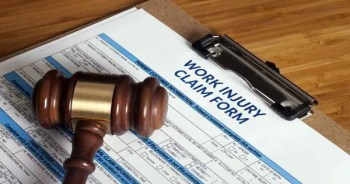 blog picture of work claim injury form on clipboard and a gavel laying on top