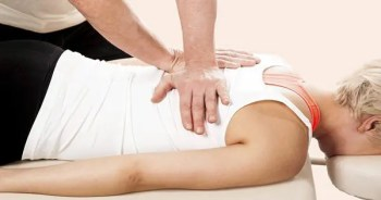 blog picture of lady getting chiropractic adjustment on chiropractic table