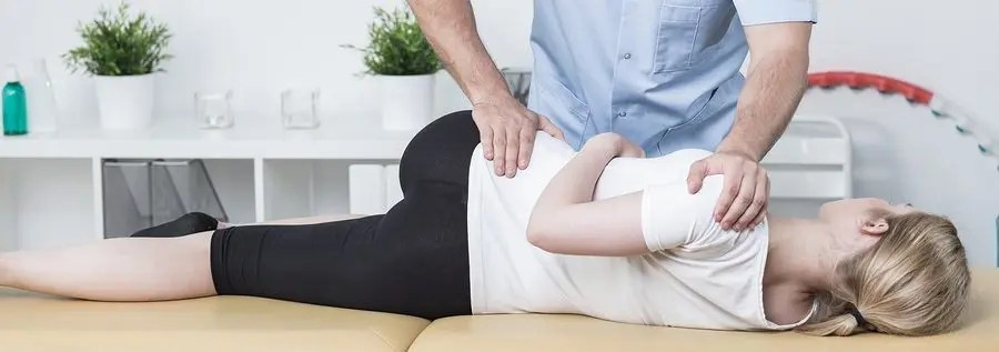 blog picture of young woman getting hip adjusted by chiropractor