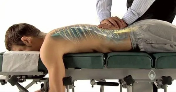 blog picture of man with see through back lying down getting a chiropractic adjustment