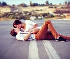 blog picture of man and woman lying down on the road making out