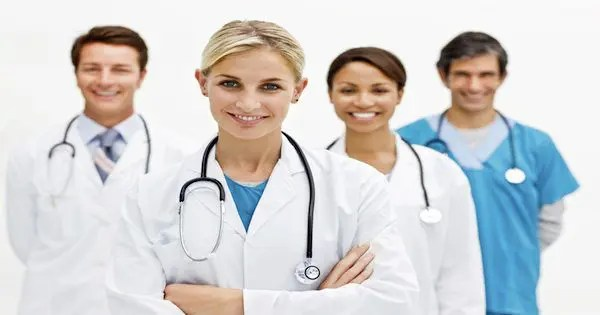 blog picture of two male doctors and two female doctors together smiling