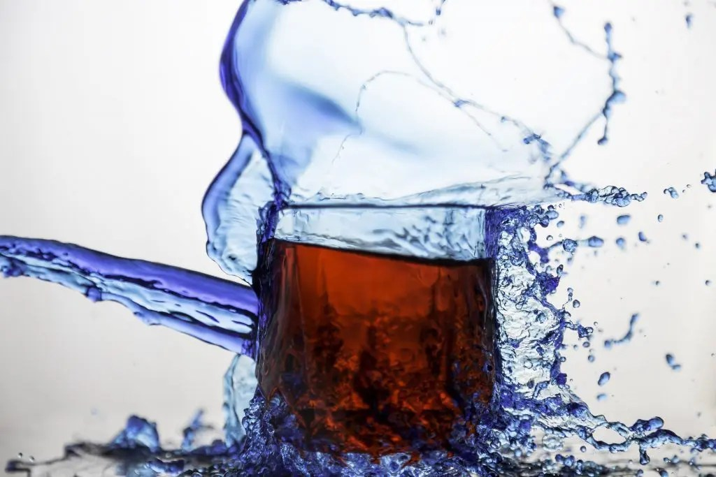 blog picture of glass of vinegar with water splashing around