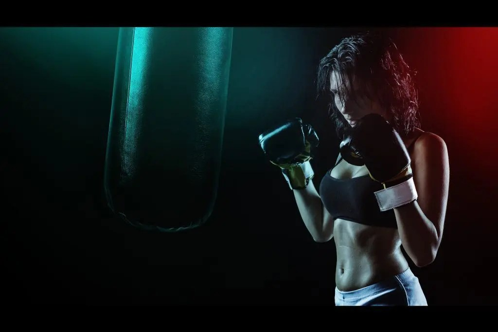 blog picture of female boxer practicing with punching bag