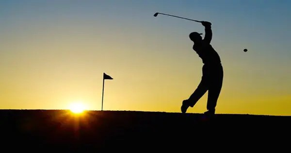 blog picture of golfer playing at sunrise
