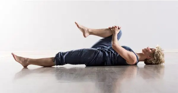 blog picture of lady stretching her leg on the floor