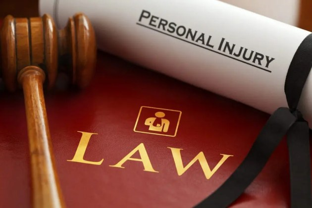 blog picture of gavel, law book, and scroll with the words personal injury