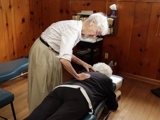 blog picture of oldest living practicing chiropractor working on a patient