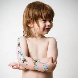 blog picture of little boy with kinesiology tape