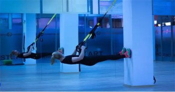 blog picture of lady working out in studio with bands