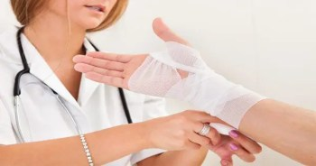 blog picture of nurse wrapping a patients wrist