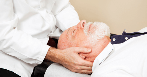 Image of an older man receiving chiropractic care for migraine relief.