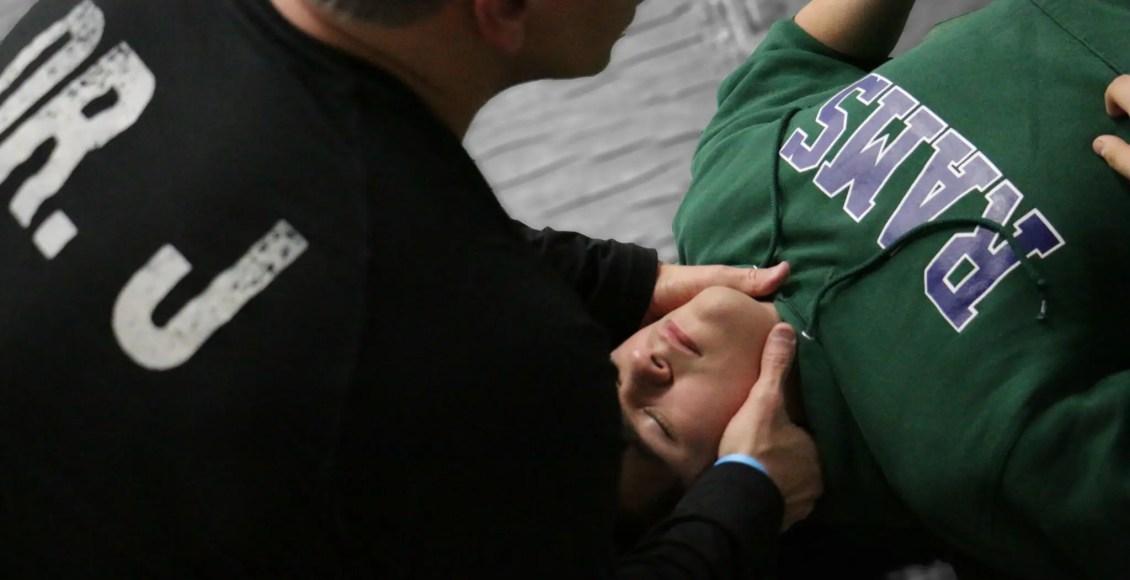 Dr Jimenez works on wrestler's neck_preview