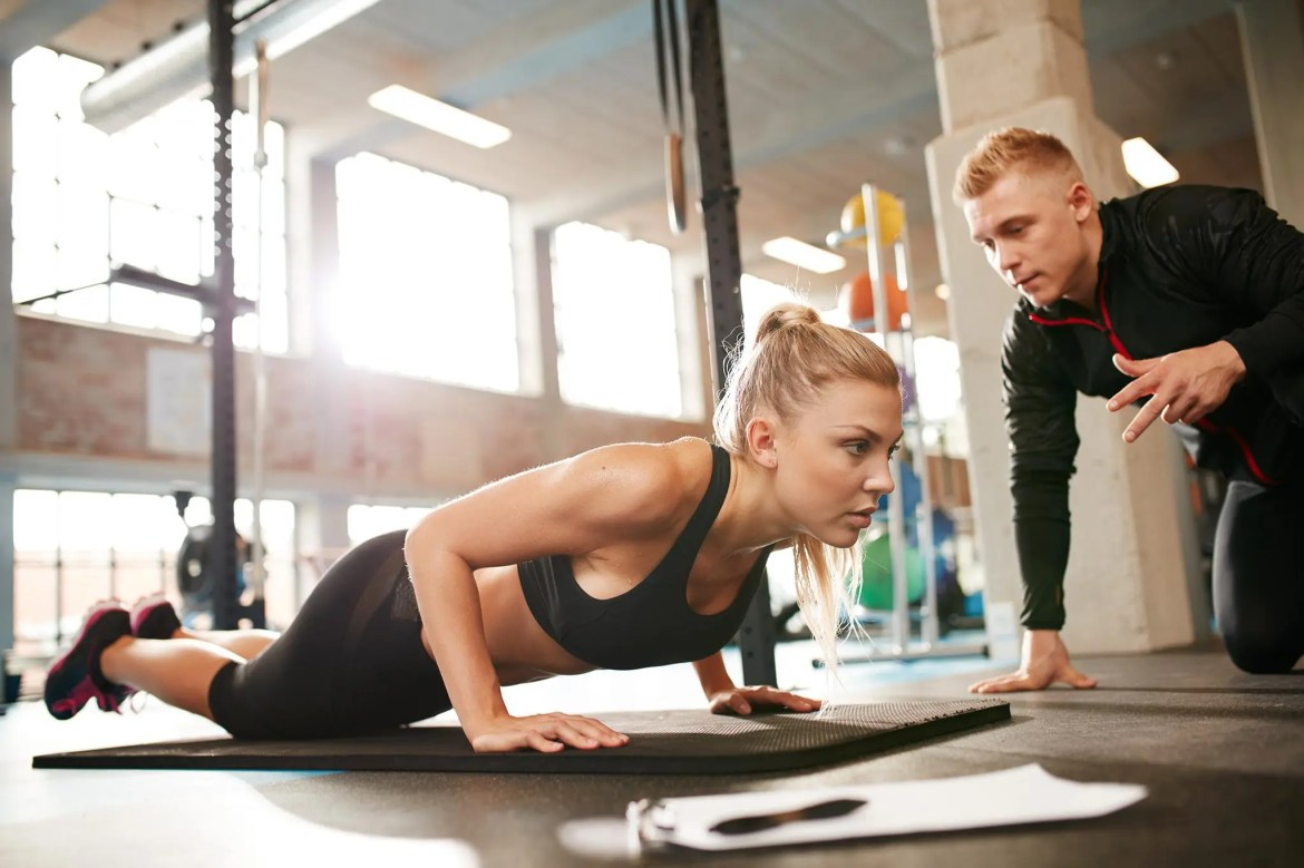 Personal Trainer Encouraging Patient to Engage in Endurance Exercises
