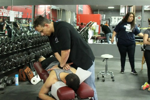 Dr Jimenez using chiropractic care on patient