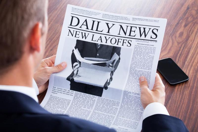 Close-up Of Businessman Reading News
