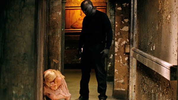 colli - New Still From The Collection Towers Over a Victim; Trailer Hitting Wednesday!
