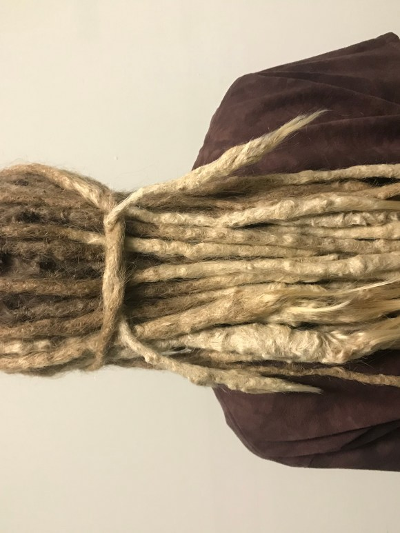 Long blonde dreadlocks directly after routine maintenance.