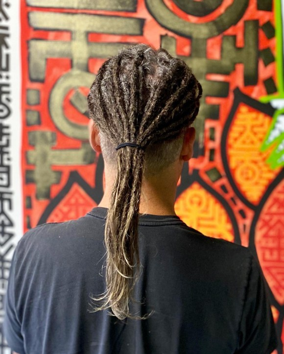 A picture of one of my clients following a dread installation appointment. He has a slight taper and partial dreadlocks on the sides/top.