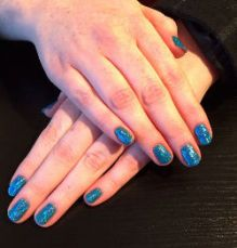 image of nails painted in shiny blue nail polish