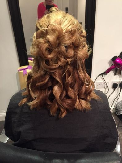 Image of a curly up-do styled by Claire