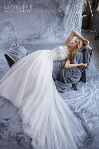 Katie Wedding Dress A Crystal Beaded Embroidered High Neck Bodice Perfectly Compliments the Soft English Net Skirt of this A-Line Bridal Gown. Removable Beaded Net Belt Included. Belt Also Sold Separately as Style 11281. Shown in Ivory/Crème