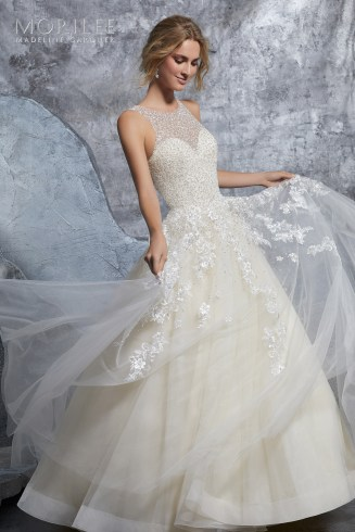 Kiara Wedding Dress Classic Bridal Ballgown Featuring a Dazzling Crystallized Bodice on Tulle Skirt. Embroidered Appliqués and Horsehair Trim Accent the Skirt. Available in Three Lengths: 55″, 58″, 61″. Shown in Ivory/Champagne