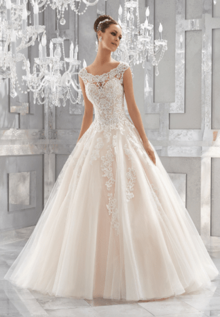 Massima Wedding Dress A Fairytale Ballgown is Brought to Life with Crystal Beaded, Embroidered Lace Appliqués and a Full Tulle Skirt. An Elegant Off-the-Shoulder Neckline and Intricate Illusion Back Complete the Look. Shown with Headpiece Style HP2019. Shown in Ivory/Blush.