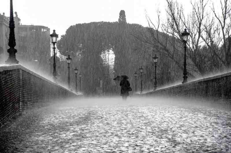 rainy day, woman on bridge