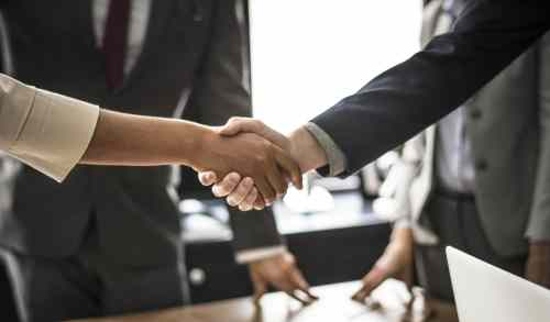 handshake group business woman