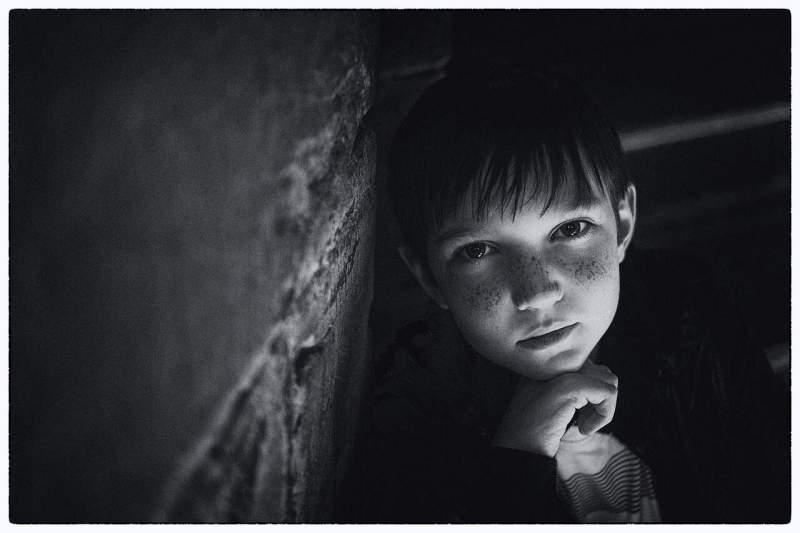 boy leaning on wall