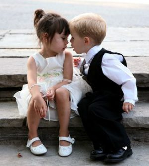 Young Boy and Young Girl Whispering