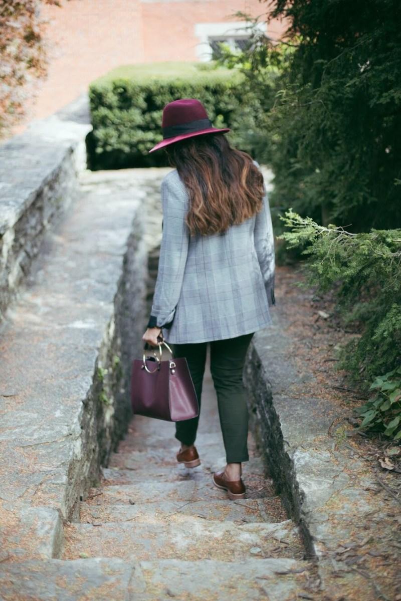 Lifestyle blogger Surekha of dreaming loud wearing Mango metal handle shoulder bag in burgundy