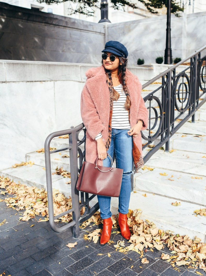 Lifestyle Blogger Surekha of dreaming loud wearing toyshop faux fur coat with boater hat and red booties