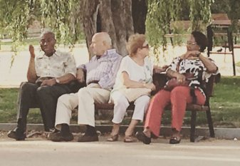Grand Parents sitting at a park