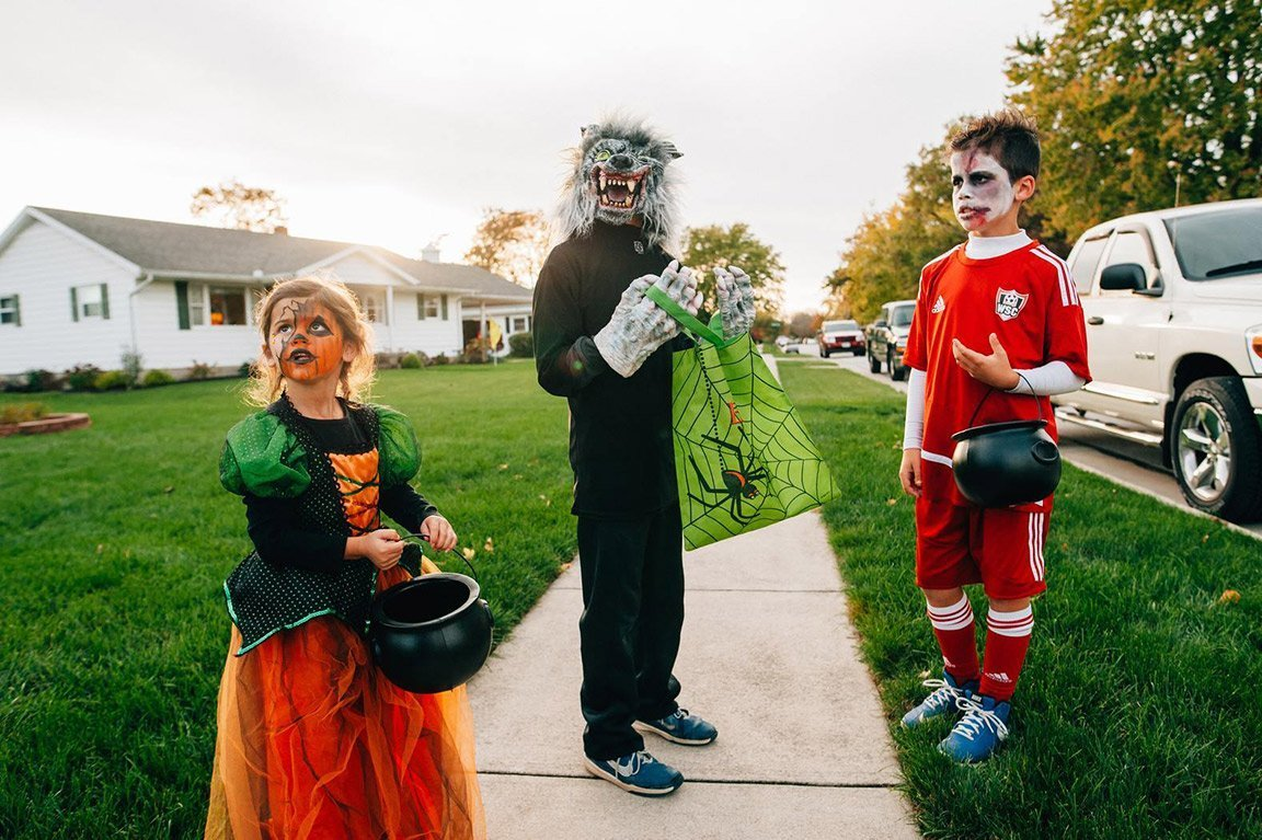 children dress up for halloween trick or treating