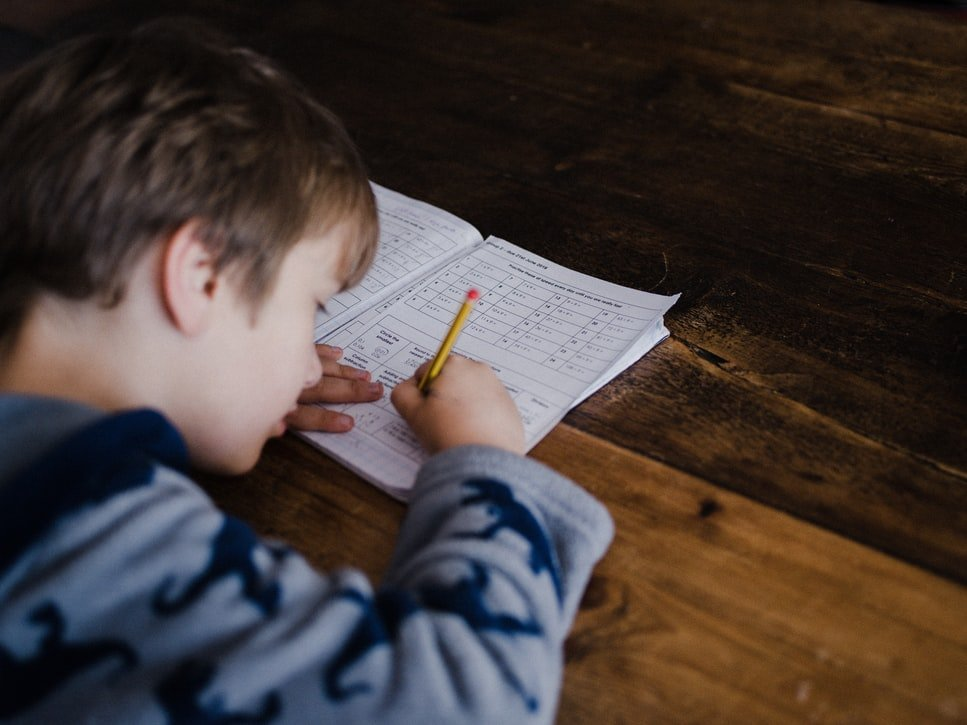 a photo of a child taking a test