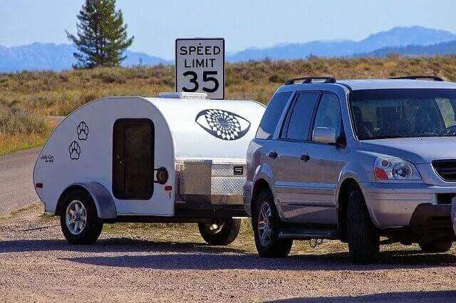 Teardrop trailer towed by an SUV