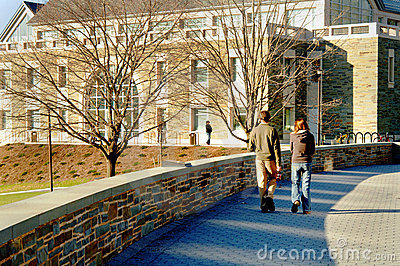 Students Walking On Campus Royalty Free Stock Image - Image: 5343086