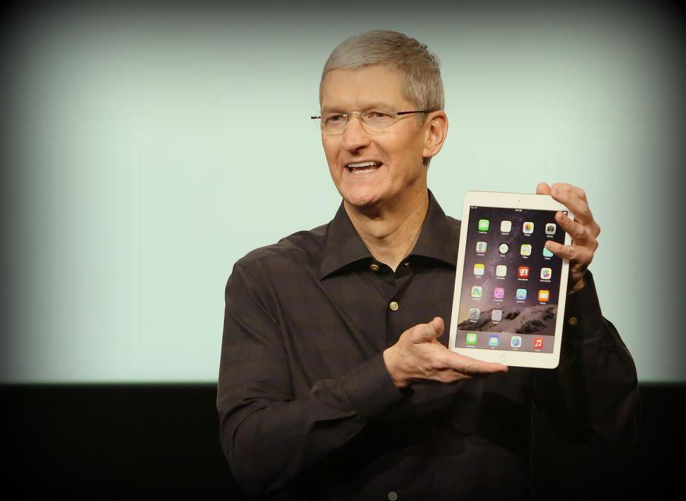 Apple CEO Tim cook with iPad air 2