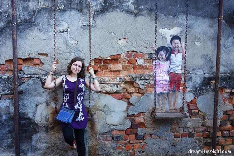 "Street art ""brother and sister on a swing"""