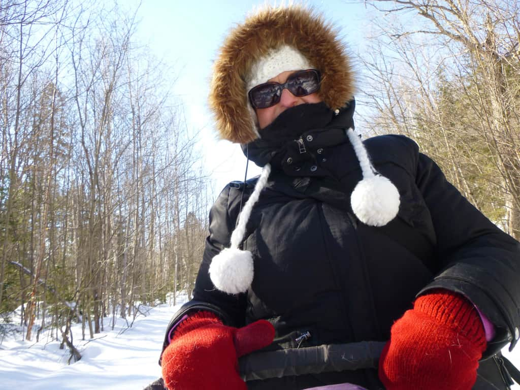 Winterdance-dog-sled-tour-driving the sled-mary