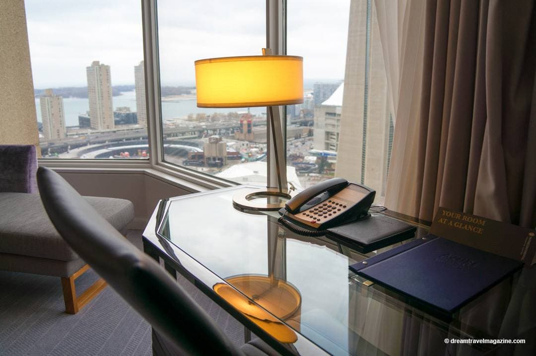 Business desk with lots of electrical outlets and a beautiful view of Toronto's Waterfront