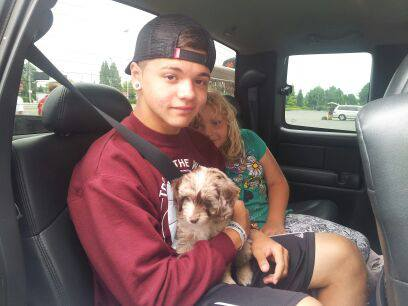 My Son and Daughter on the way to the airport with a Mini Aussiedoodle Puppy!