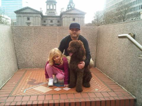My husband and daughter with Daisy downtown Portland, OR