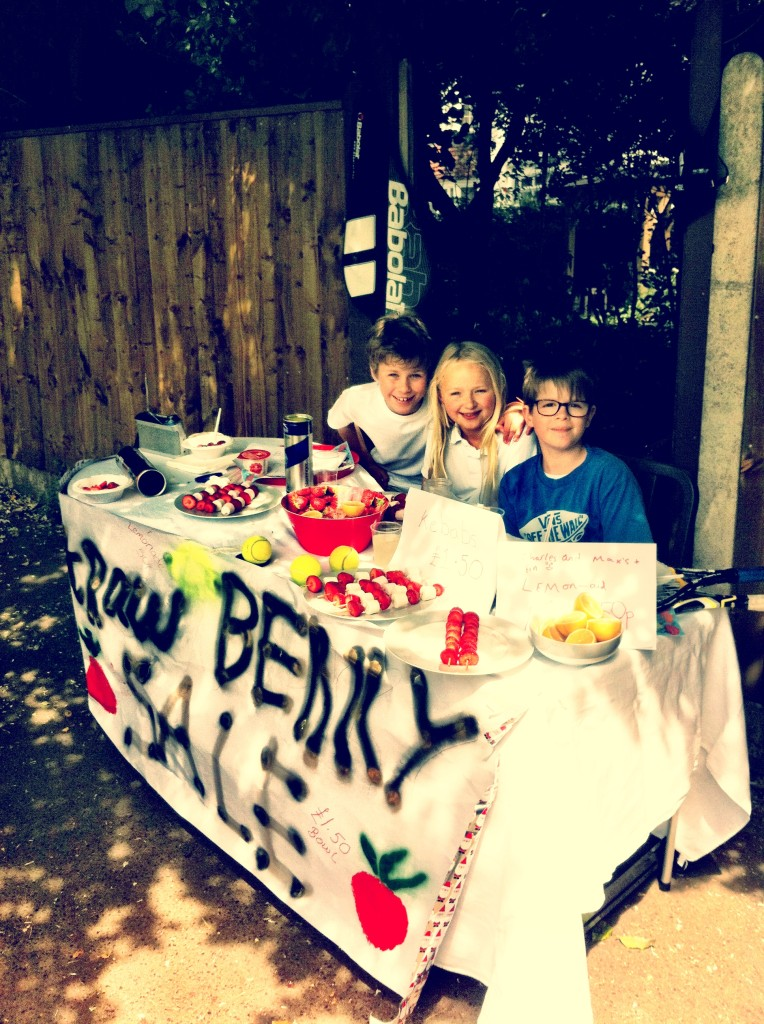 Kids selling strawberries and cream at Wimbledon tennis competition 2013