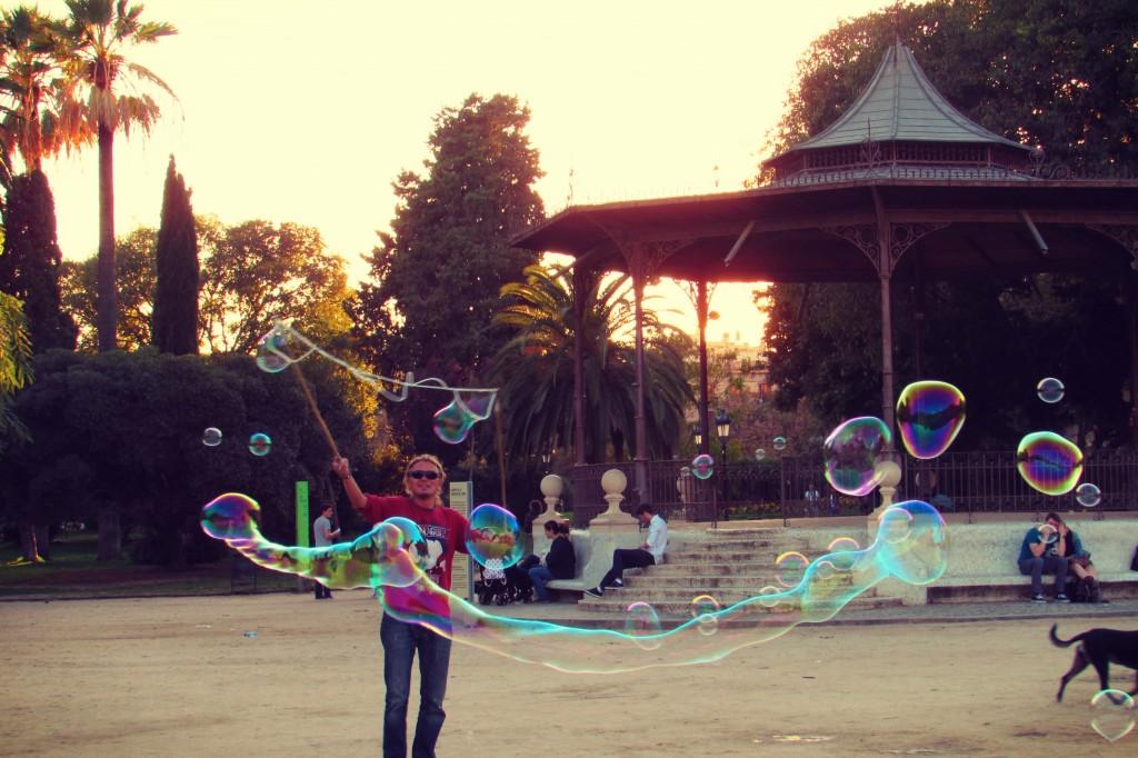 Blowing bubbles in Parc de la Ciutadella Park in Barcelona