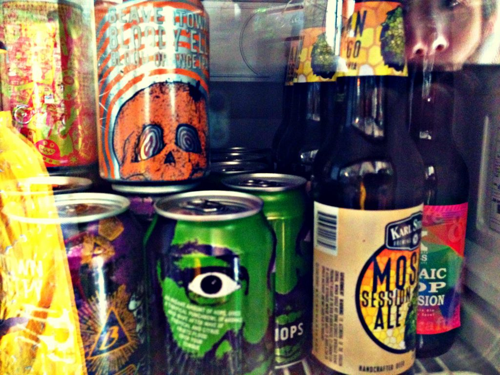 craft beer cans and bottles in the fridges at Oma Bistro in Eixample Barcelona