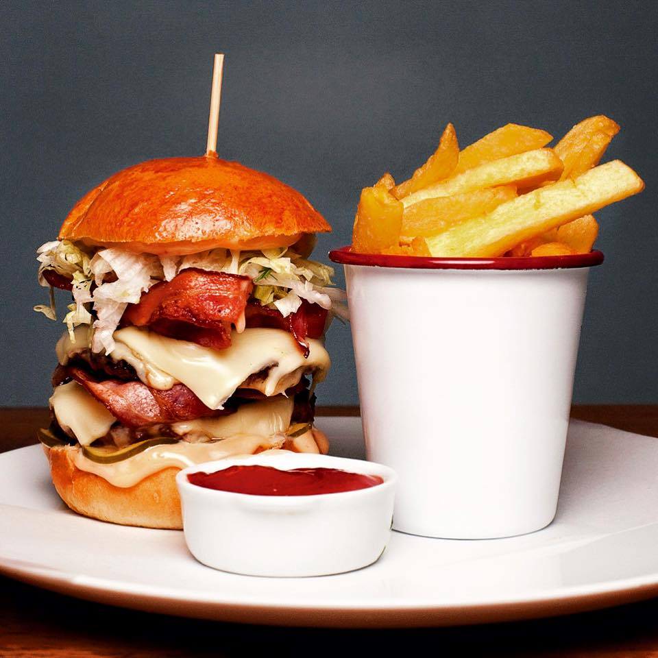 Double cheese burger with bacon and cheddar at Caravelle in Raval Barcelona